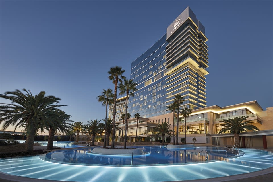 Swimming pools illuminated in the evening light at Crown Towers, Perth, Western Australia