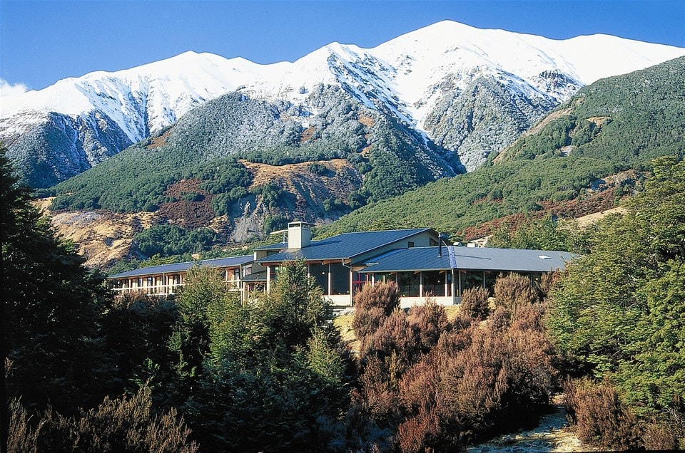 New Zealand's Southern Alps form backdrop for large hospitable lodge near Arthurs Pass National Park, Wilderness Lodge
