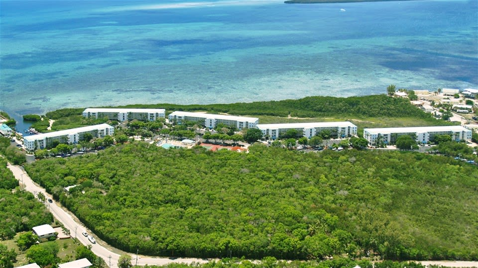 Ariel view of the Ocean Pointe Suites Resort in the Florida Keys with lush gardens and ocean access