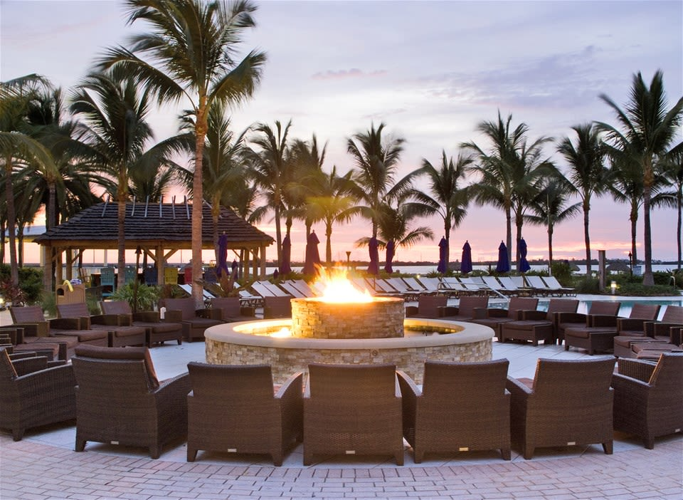 Fire put surrounded by Wicca chairs overlooking the ocean during sunset at the Hawks Cay Resort Florida Keys