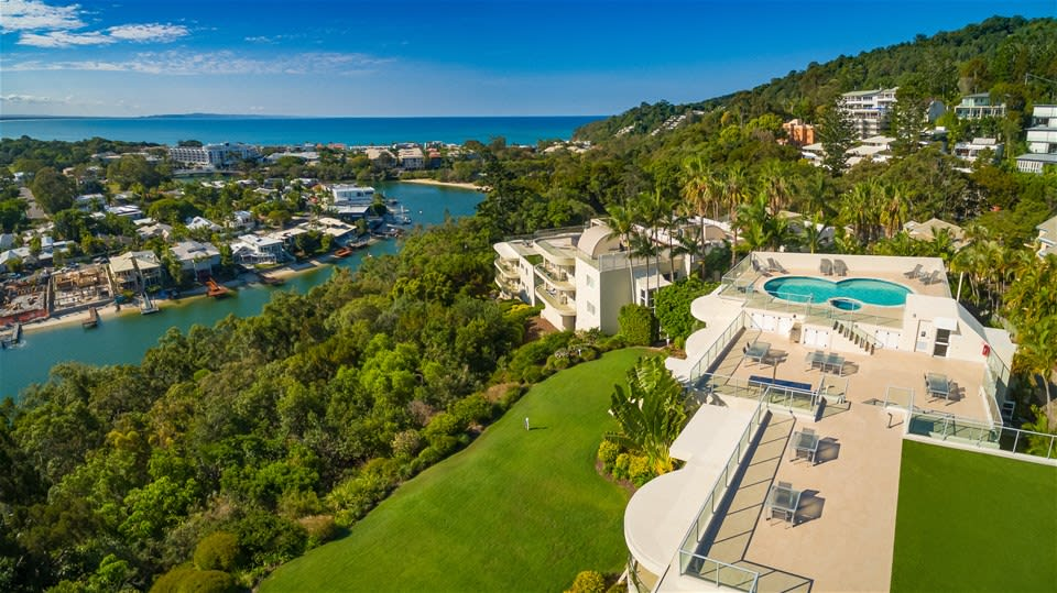 Hillside view of secluded pool area, Noosa River and stunning ocean at Noosa Crest, Noosa Heads, Queensland, Australia