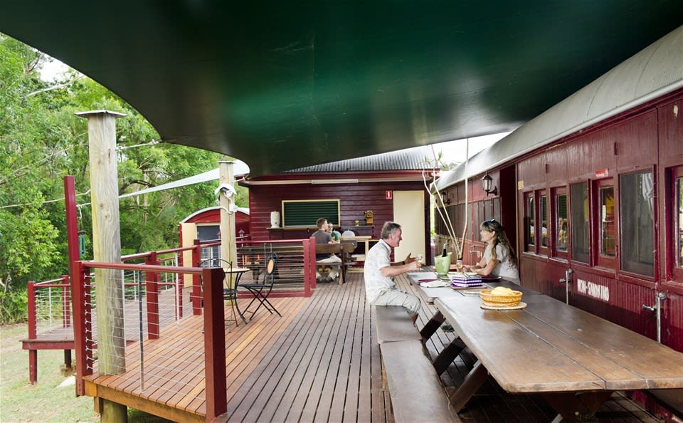 Breakfast for two on the converted train carriage deck at Glasshouse Mountains Ecolodge, Queensland, Australia