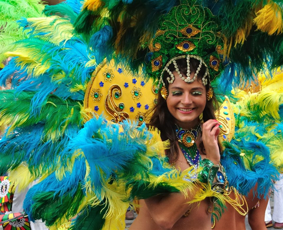 Carnival dancer in traditional blue, yellow and green clothes, on Rio Carnival - Winners Parade, Rio De Janeiro, Brazil.